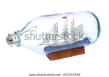 Boat in a bottle isolated in whitebackground - stock photo