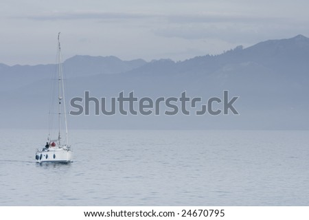 boat in a calm water lake at a foggy scenery