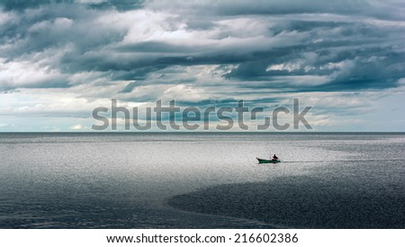 boat in a stormy sea - stock photo