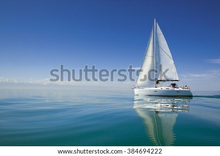 Boat in sailing regatta. Luxury yachts. Sailing yacht on the water - stock photo