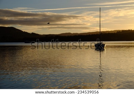 Boat in the evening sun - stock photo