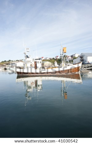 boat in the harbor, Iceland - stock photo