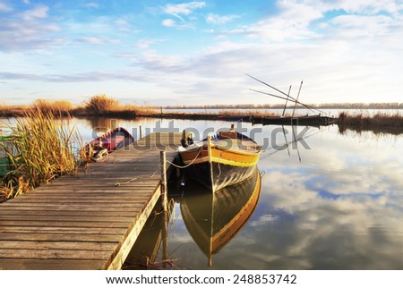 boat in the harbor of the river - stock photo