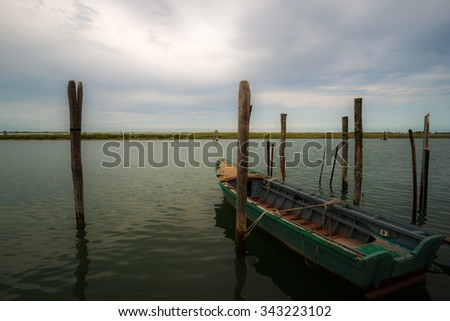 Boat in the lagoon of Venice - stock photo