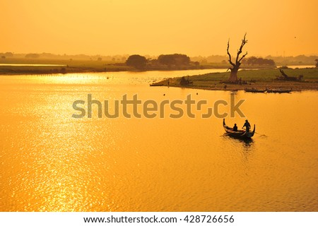 Boat in The Lake During Sunset - stock photo