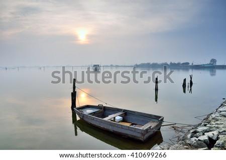 boat in the lake in Comacchio,Italy, in winter - stock photo