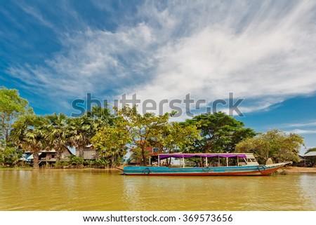 Boat in the lake near the fishing village. Cambodia - stock photo