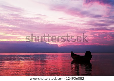 Boat in the sea on sunset