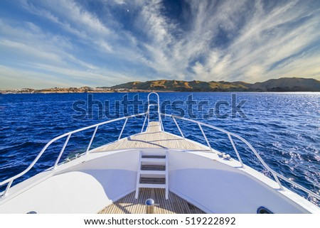 Boat in the tropical sea against a background of the mountains