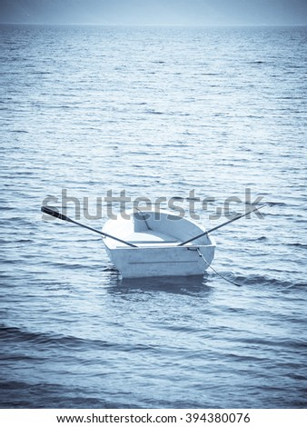 boat in the water with vignette - stock photo