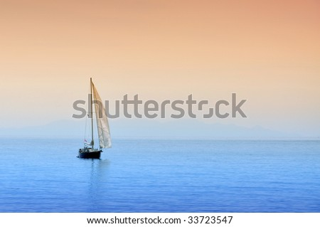 Boat is sailing on the sea in the sunset.