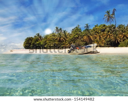 Boat landed on the shore of a beautiful tropical beach, Bocas del Toro archipelago, Caribbean sea, Panama