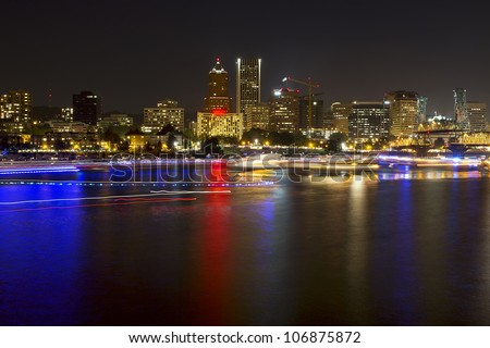 Boat Lights Trails Along Willamette River the City Skyline of Portland Oregon Waterfront at Night - stock photo