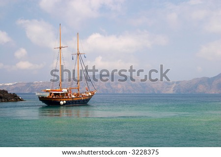 boat Mediterranean sea Santorini island Greece - stock photo