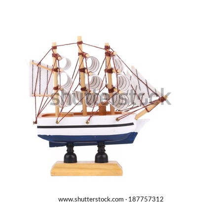 Boat model. Small wooden ship. Isolated on a white background. - stock photo