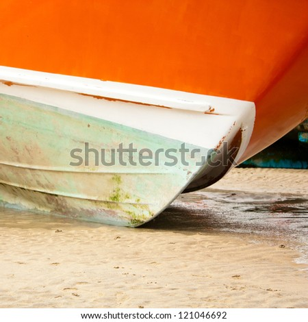 Boat moored at low tide, St Ives, Cornwall, England - stock photo