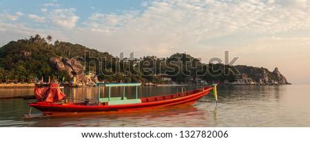 Boat on a beach at Koh Tao, Thailand. - stock photo