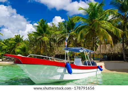 Boat on azure water, holidays, Sanoa Island,  Dominican Republic - stock photo