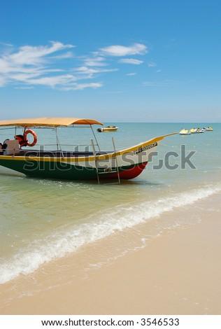 Boat on Batu Ferringhi beach, Penang, Malaysia - stock photo