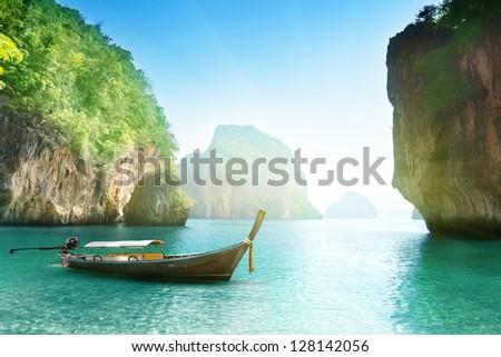 boat on beach of island in Krabi Province, Thailand - stock photo