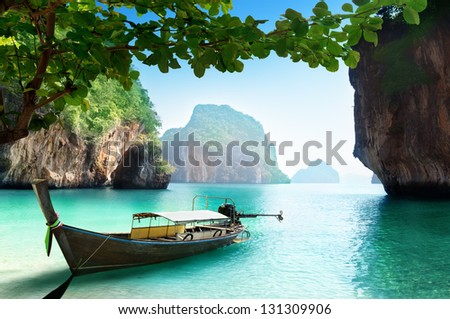 boat on beach of island in Krabi Province, Thailand - stock photo