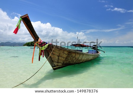 Boat on beautiful beach at Phi Phi island, Krabi, Thailand