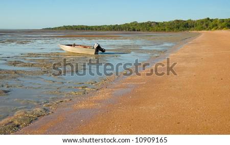 Boat on Mudflats at West Alligator Head in Kakadu National Park, Australia. Taken under permit. - stock photo