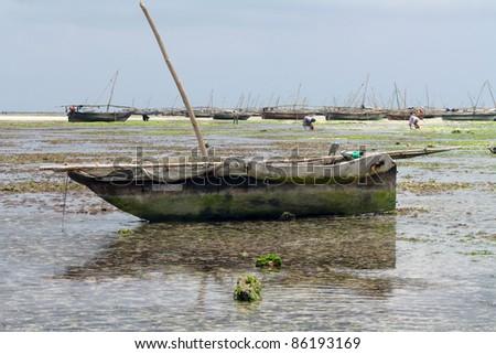 Boat on Nungwi white-sand beach, Zanzibar - stock photo