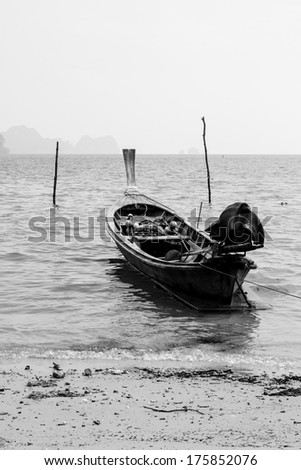 Boat on sea beaches by rural folkways - stock photo