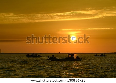 Boat on sea during sunset