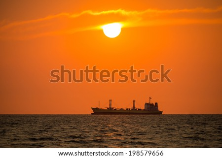 Boat on sea during sunset - stock photo