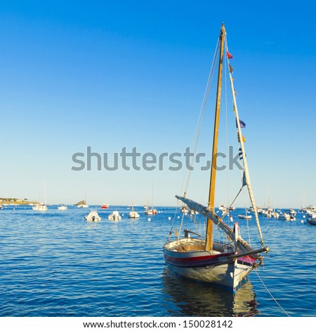 Boat on the Dock in Cadaques, Costa Brava in Catalonia, Spain. - stock photo