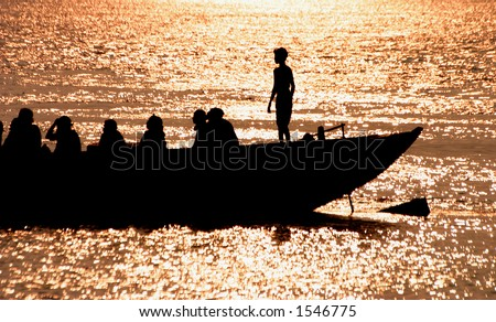 Boat on the Ganga river, India. - stock photo