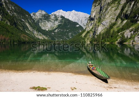Boat on the shore of green water Obersee lake, Berchtesgaden National Park, Bayern, Germany