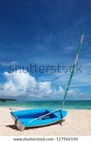 Boat on the shore of the lagoon on the background of the rainbow. Maldives, Rasdhoo Atoll, Kuramathi Island - stock photo