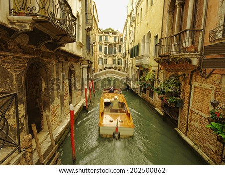 boat on Venice narrow canal - stock photo