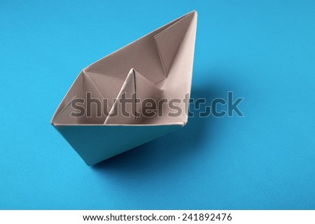 boat paper origami on the blue background - stock photo