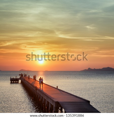 Boat pier at sunset. Beautiful landscape. - stock photo