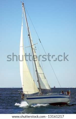 Boat plowing the sea in a sunny day - stock photo