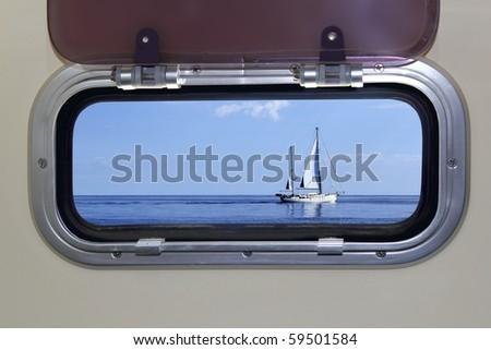 Boat porthole sailboat view blue ocean sea sky horizon [Photo Illustration] - stock photo
