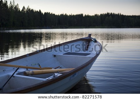 Boat prepared to start a course at the lake - stock photo