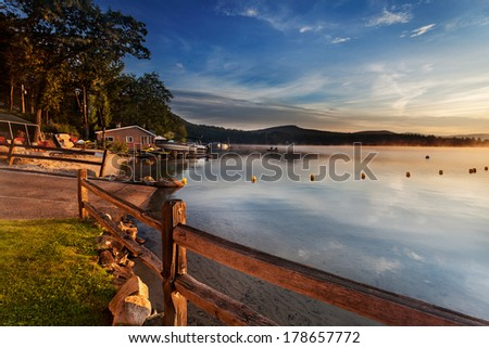 Boat ramp at the marina, Merrymeeting Lake, New Hampshire, on a sunny summer morning - stock photo