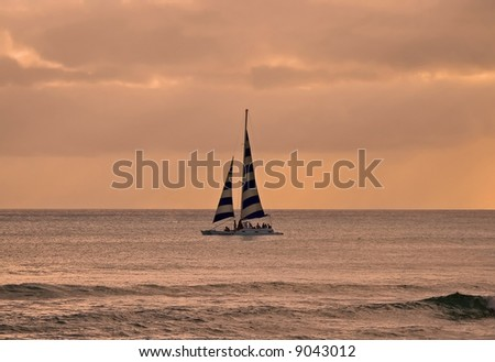 Boat sailing at sunset in Hawaii