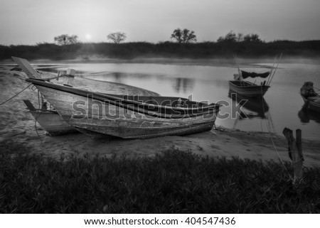 Boat stop on sea at sunset before night and peace time - stock photo
