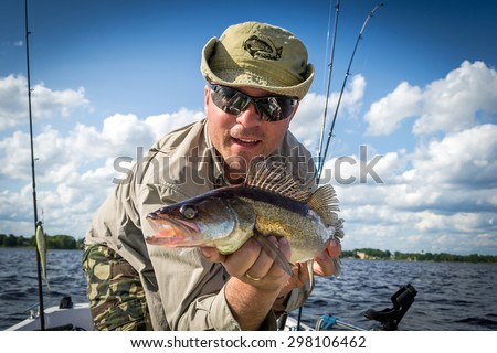 Boat summer fishing for walleye - stock photo