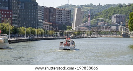 Boat surfing the estuary of Bilbao.