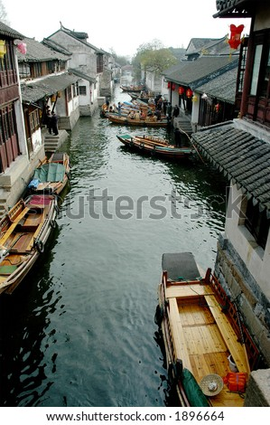 Boat traffic on the narrow river of a southern Chinese town. More with keyword Series11A