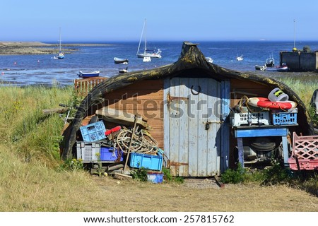 boat transformed to a shed, Lindisfarne, Northumbria, England, United Kingdom, Europe - stock photo
