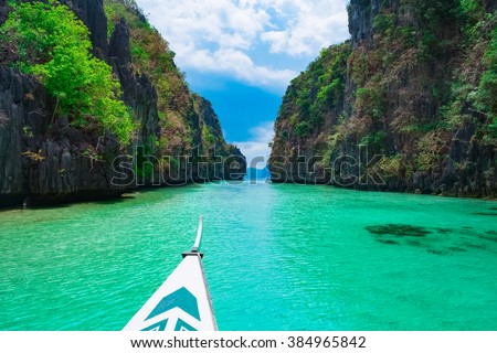 Boat trip in blue lagoon, Palawan, Philippines - stock photo