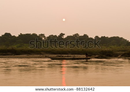 Boat trip on the wild river in Chitwan Nepal - stock photo